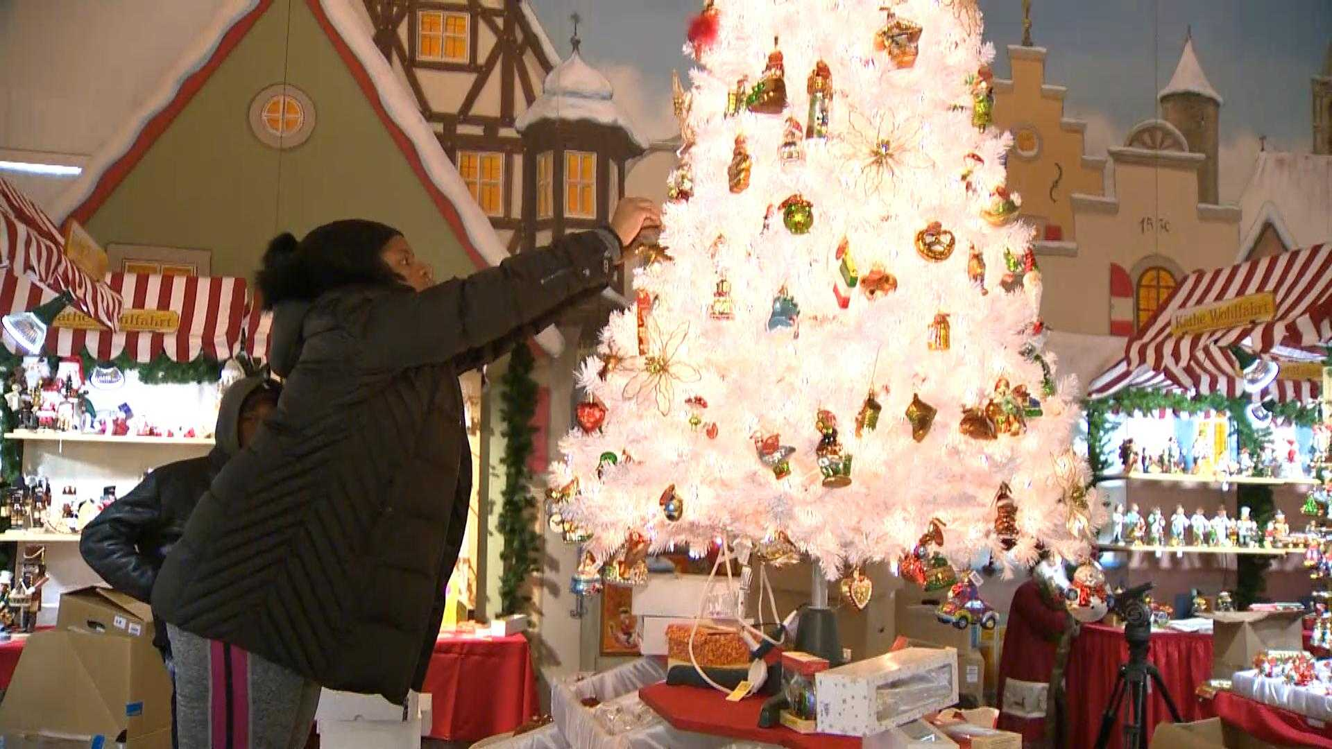 Organizers work to set up the Christmas Village, which will be open from Thanksgiving to Christmas Eve,