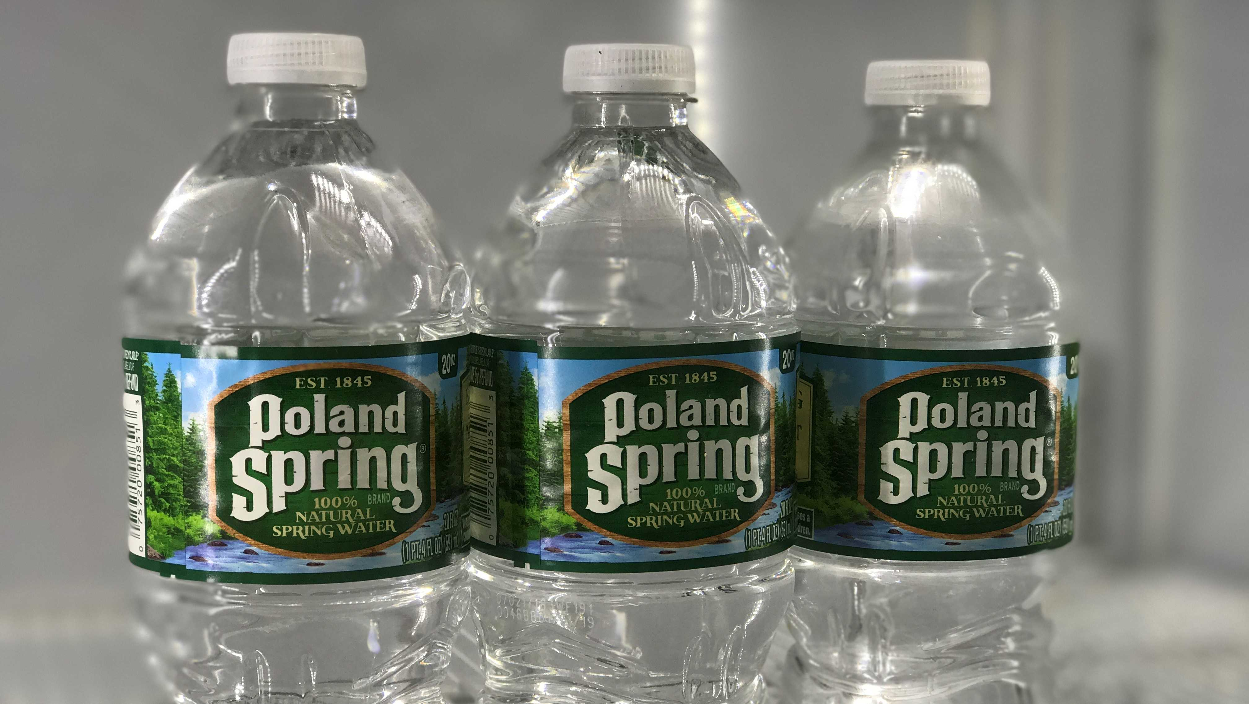 Poland Spring bottled water sits in a cooler in a store in Needham, Mass.