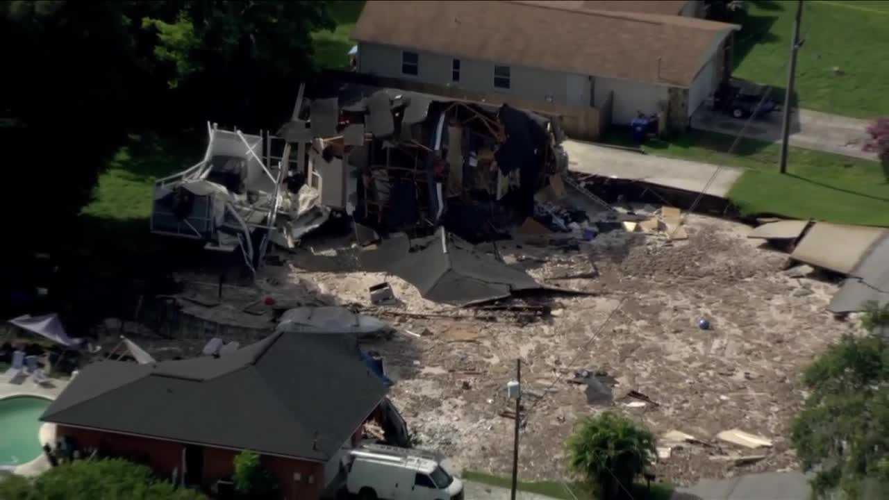 sinkhole swallows homes in pasco county neighborhood