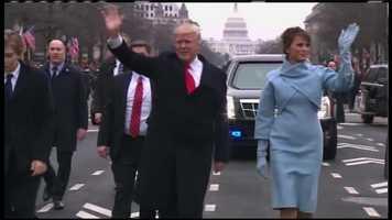 Donald and Melania Trump wave in the inaugural parade