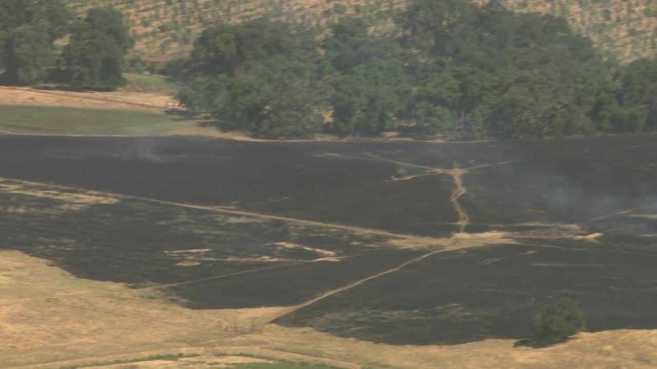 Crews battle a grass fire, called the Clay Fire, near Herald in Sacramento County on Thursday, June 1, 2017.
