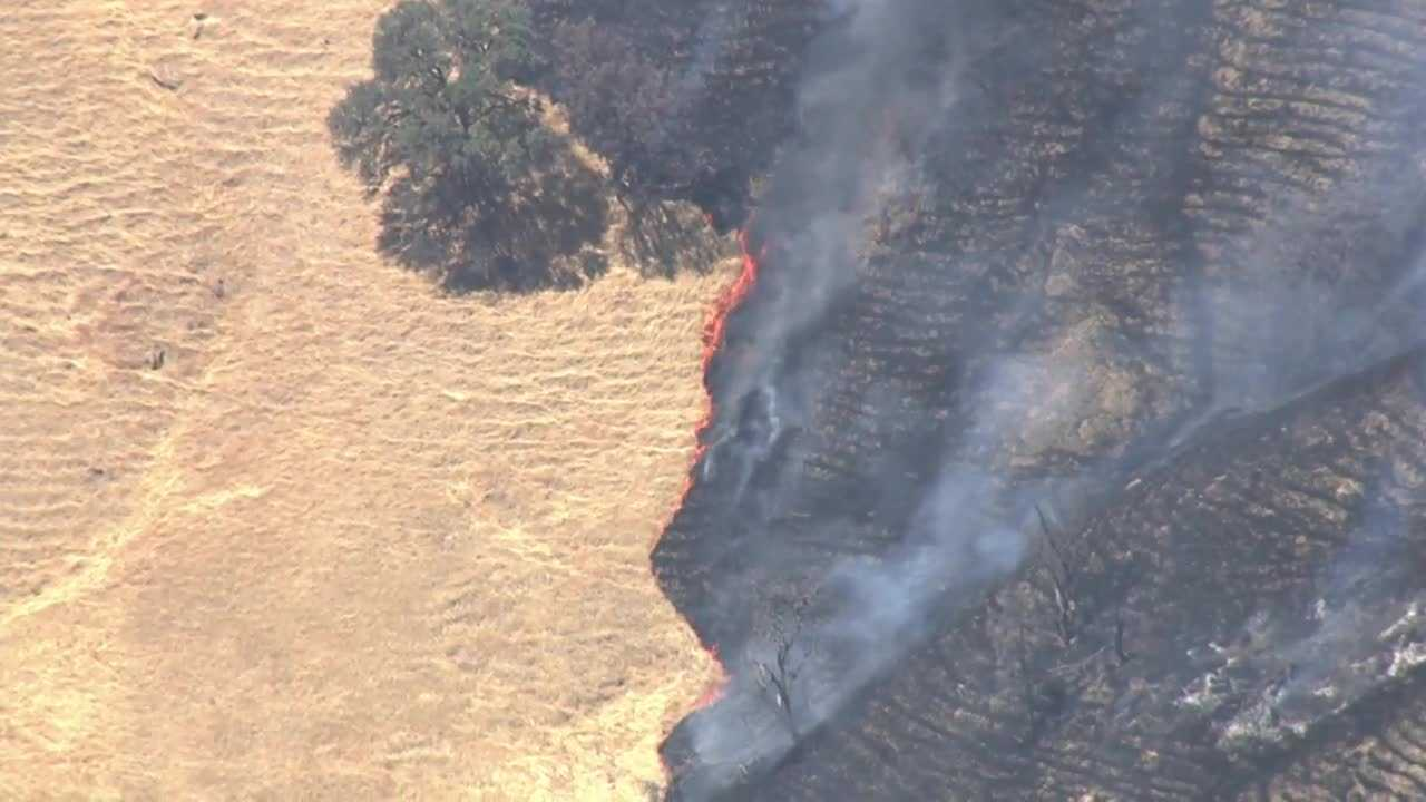 Fire spreads in tinder-dry Yolo County grassland; aerial attack mounted