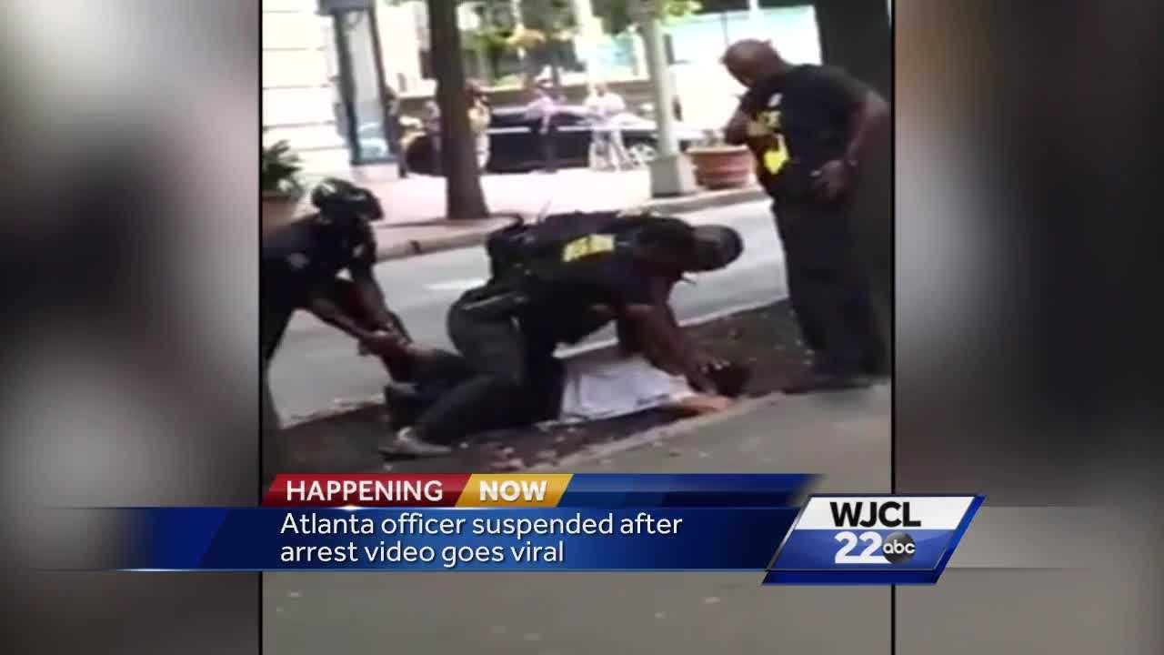 Officer seen punching man on ground during arrest in Atlanta