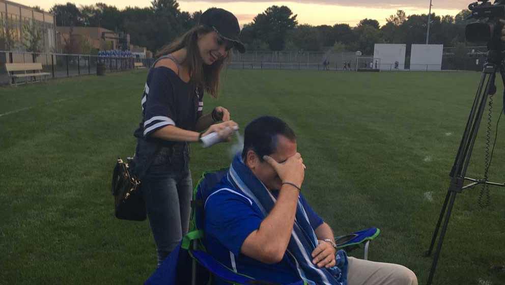 Students dye Principal Bill Runey's hair blue