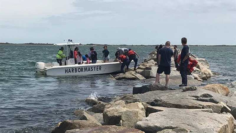 44 people rescued after high tide traps them on breakwall