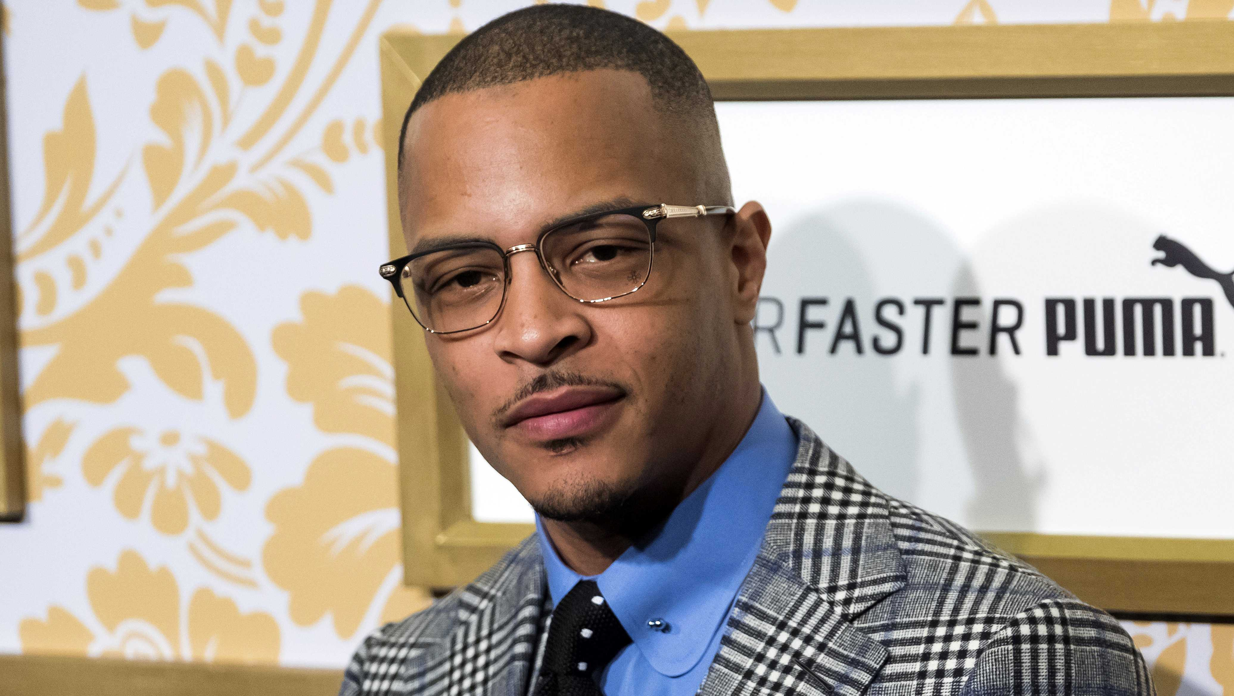 FILE - In this Jan. 27, 2018 file photo, T.I. attends the Roc Nation pre-Grammy brunch in New York. Police say rapper T.I. has been arrested for disorderly conduct and public drunkenness as he tried to enter his gated community outside Atlanta.