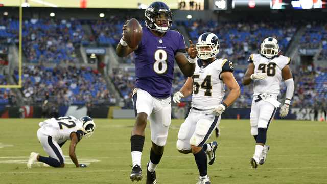 Baltimore Ravens quarterback Lamar Jackson (8) scores a touchdown in the first half of a preseason NFL football game against the Los Angeles Rams, Thursday, Aug. 9, 2018, in Baltimore.