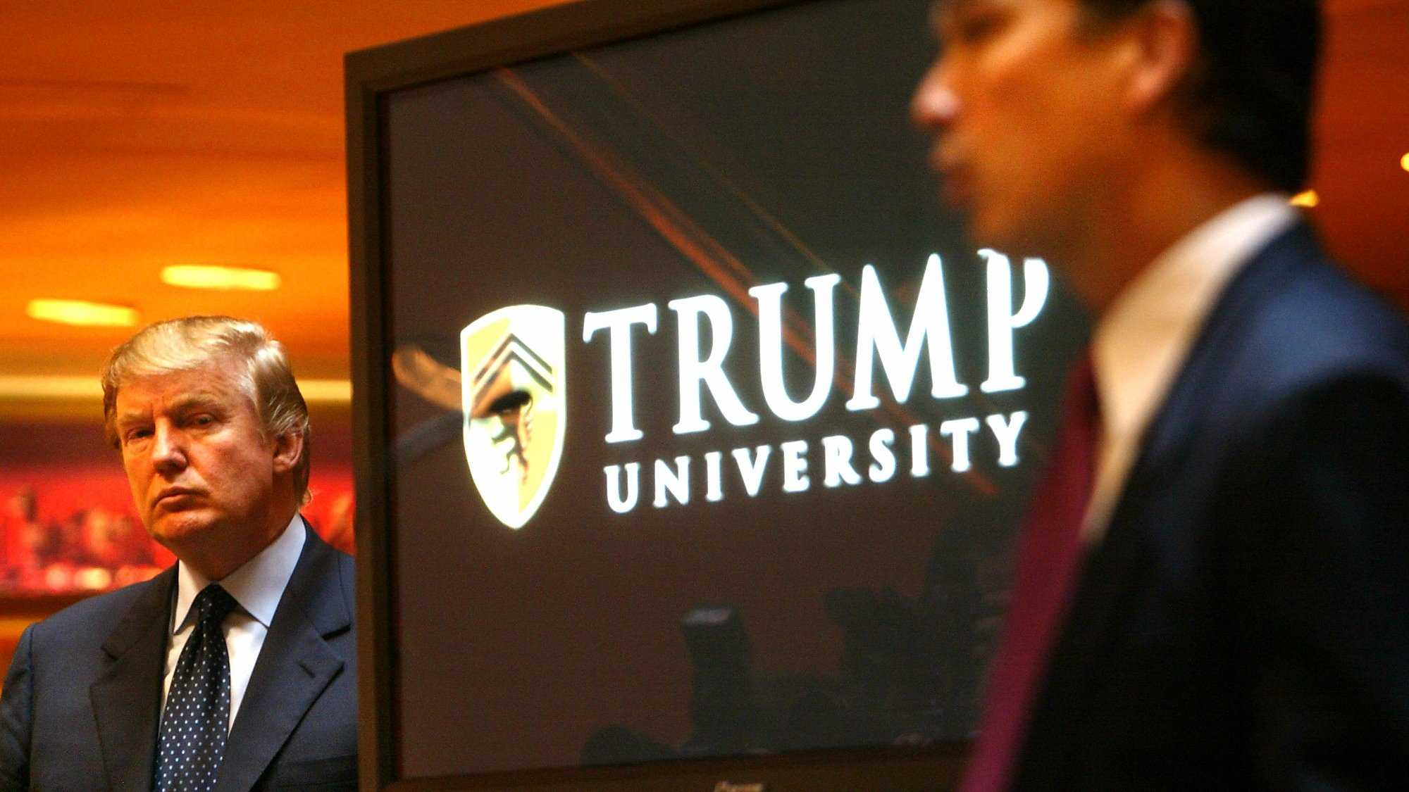 In this Monday May 23, 2005 file photo Donald Trump, left, listens as Michael Sexton introduces him to announce the establishment of Trump University at a press conference in New York.