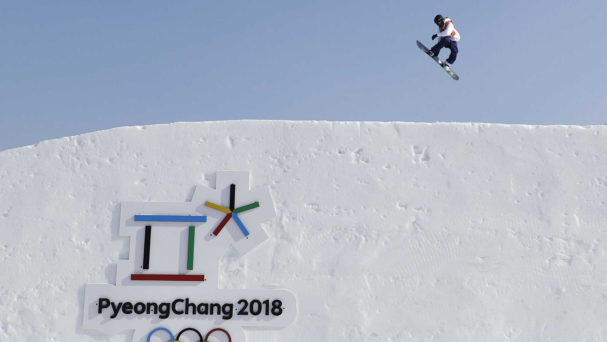 A snowboarder trains ahead for the 2018 Winter Olympics in Pyeongchang, South Korea, Thursday, Feb. 8, 2018. (AP Photo/Gregory Bull)