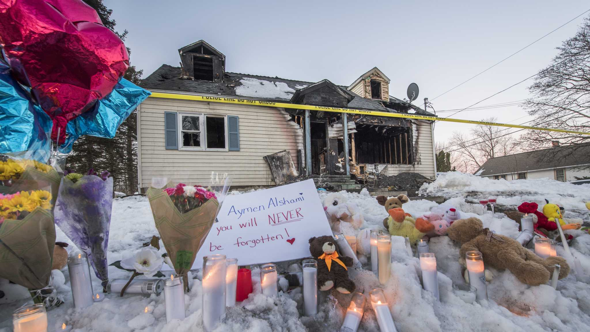 A makeshift memorial was set up in front of the burned out shell of a home which is all that is left of 900 Mann Avenue Monday March 12, 2018 after two adults and one child lost their lives in a multi-alarm fire which occurred early Sunday morning  in Rensselaer, N.Y. (Skip Dickstein/Times Union)