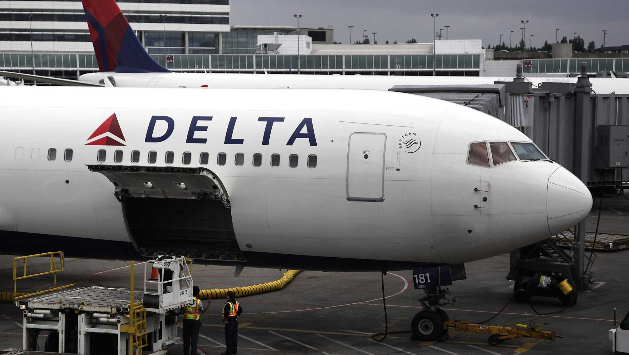 In this 2010 photo, a Delta plane sits on the tarmac at Seattle-Tacoma International Airport.