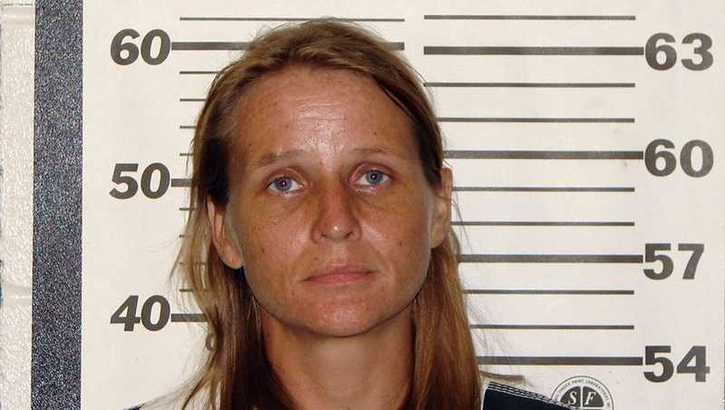 Mother charged with killing autistic daughter she gave up for adoption