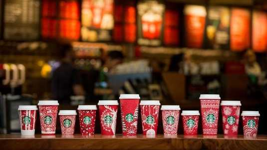 Snowflakes, Santa Claus and reindeer are returning to Starbucks' holiday cups this year, after last year's more subdued red cups caused an uproar.