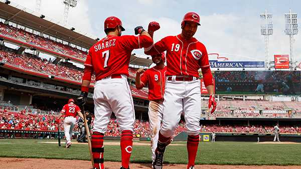 Reds rally to beat Rockies, break 7-game slide