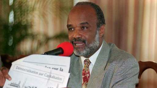 President Rene Preval defends his plan to privatize state-owned enterprises Tuesday, April 30, 1996, during a press conference at the National Palace in Port-au-Prince, Haiti. The state-owned telephone and electric companies, flour mill, and cement factory are on the controversial privatization agenda and a management concession for the port authority is being studied.