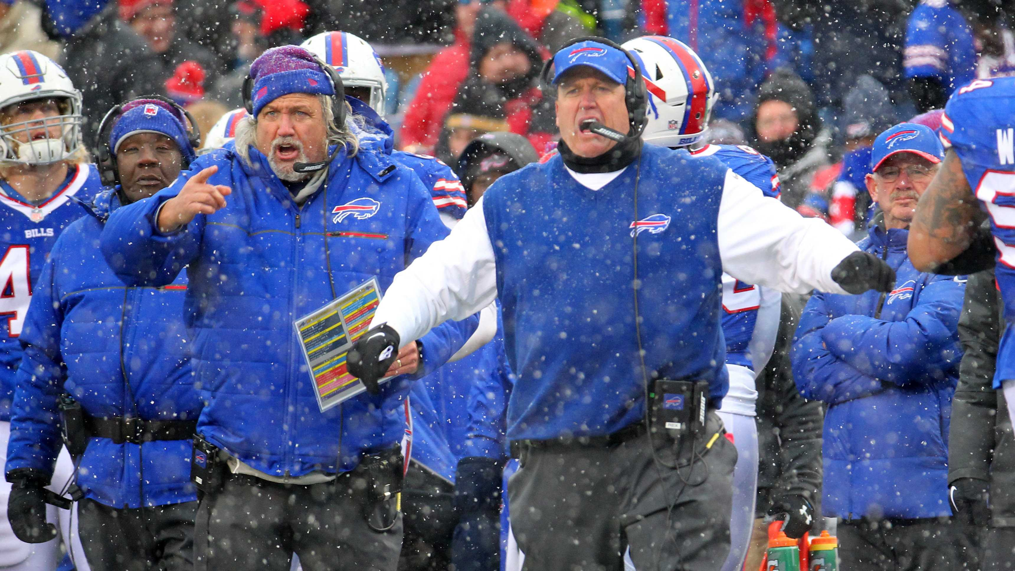 In this Dec. 11, 2016, file photo, Buffalo Bills head coach Rex Ryan, right, and his brother, assistant head coach Rob Ryan, left, react during the second half of an NFL football game against the Pittsburgh Steelers in Orchard Park, N.Y.
