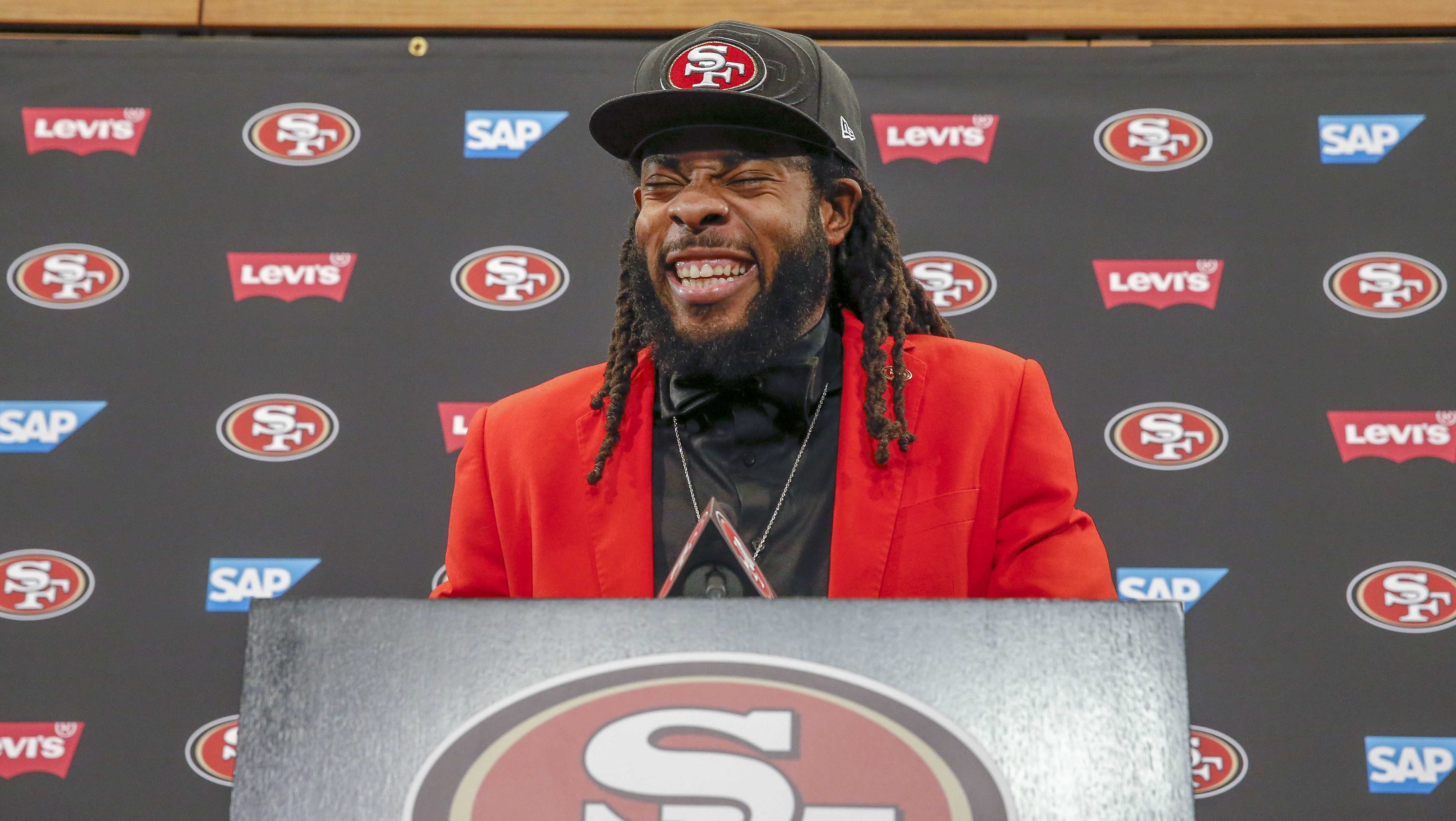 San Francisco 49ers cornerback Richard Sherman laughs as he answers questions during an NFL football news conference in Santa Clara, Calif., Tuesday, March 20, 2018.