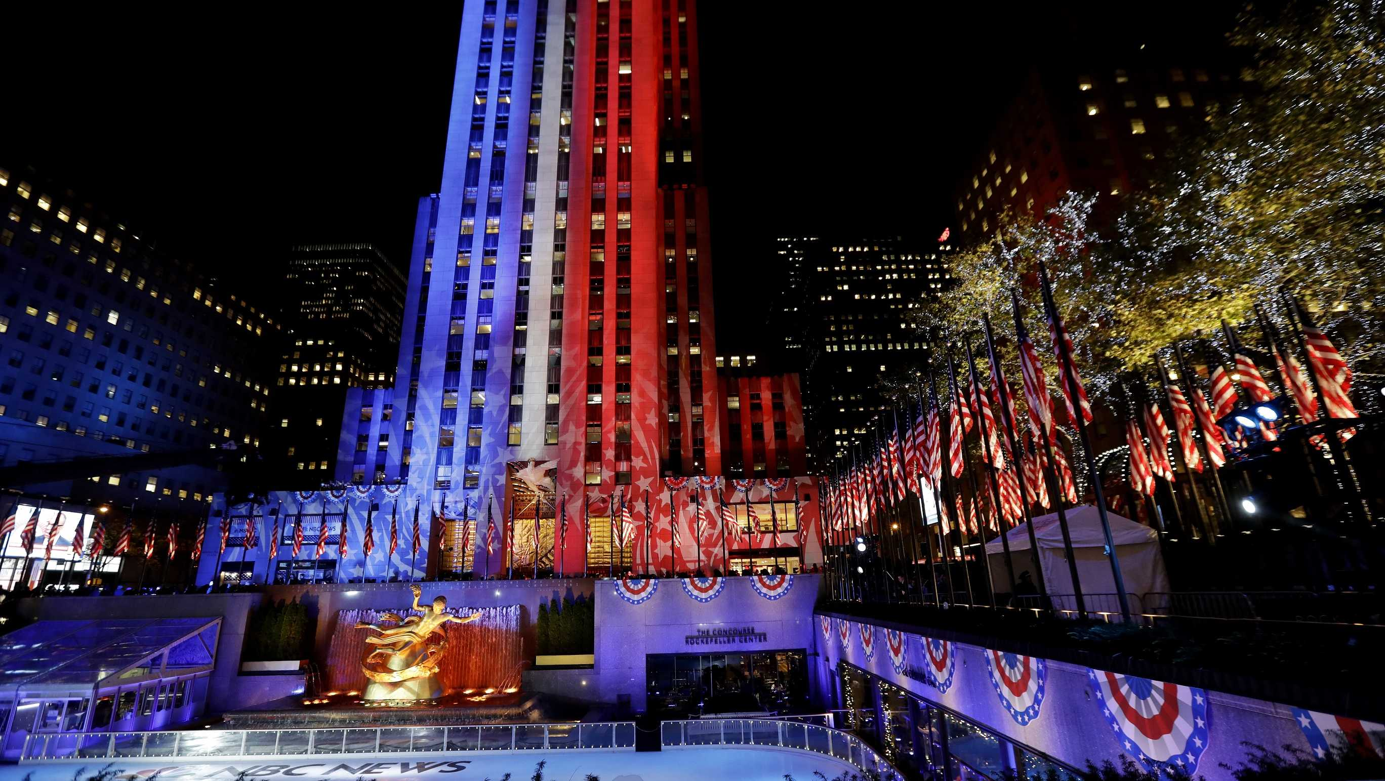Patriotic lights illuminate Rockefeller Center during an Election Day gathering at the New York City landmark