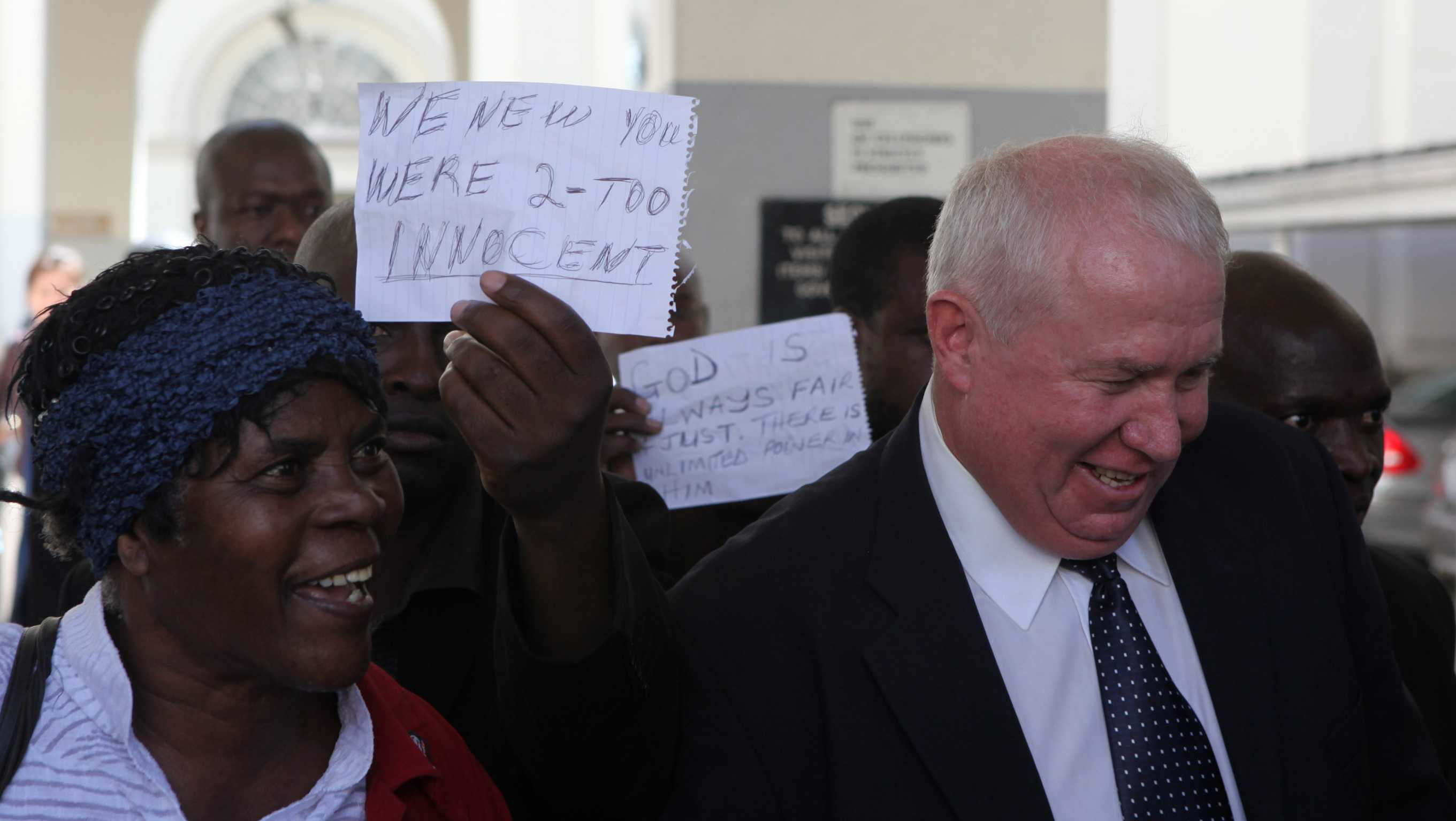 Roy Bennett, right, leaves the High Court in Harare, Monday, May, 10, 2010 after he was acquitted of terrorism charges in Zimbabwe.