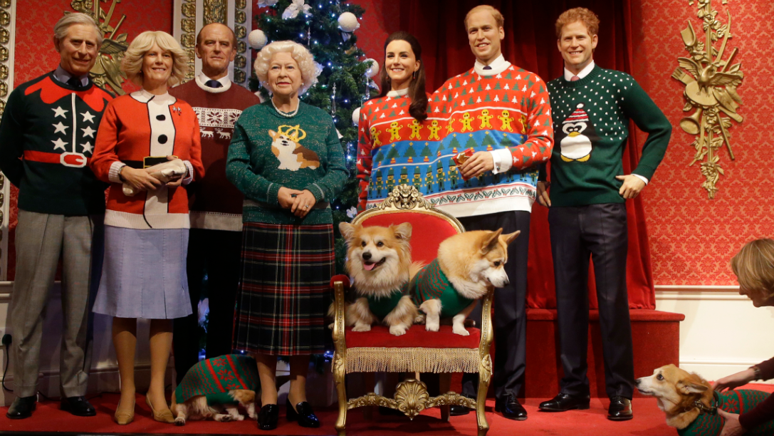 A dog owner tells her Pembrokeshire Welsh Corgi to 'stay' as four Corgi dogs pose next to wax work models of the British Royal family wearing colorful Christmas themed jumpers for a charity Christmas Jumper Day campaign at Madame Tussauds wax works in London, Tuesday, Dec. 6, 2016. The members of the royal family are from the left, Prince Charles Camilla, Duchess of Cornwall, Prince Phillip, Queen Elizabeth II, Kate, Duchess of Cambridge, Prince William, and Prince Harry.The Queen is well known for her love of this particular breed of dogs.