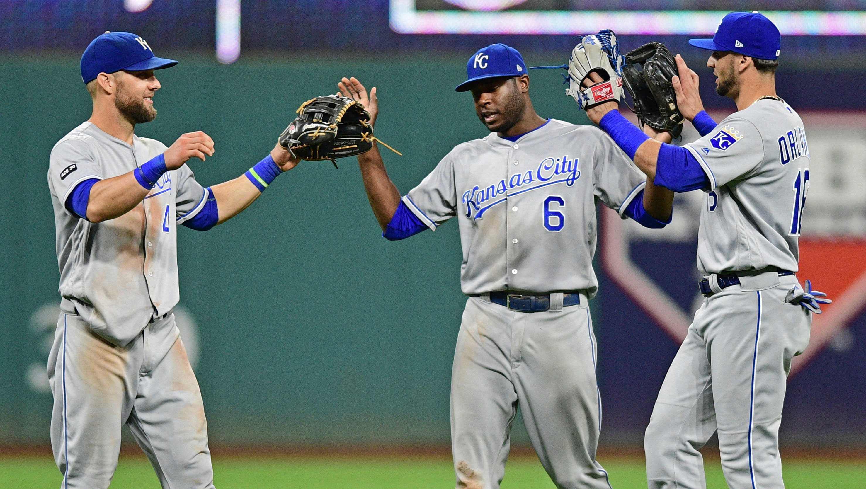 Kansas City Royals,' Alex Gordon, left, Lorenzo Cain and Paulo Orlando celebrate after they defeated the Cleveland Indians in a baseball game, Friday, Sept. 15, 2017, in Cleveland. (AP Photo/David Dermer)