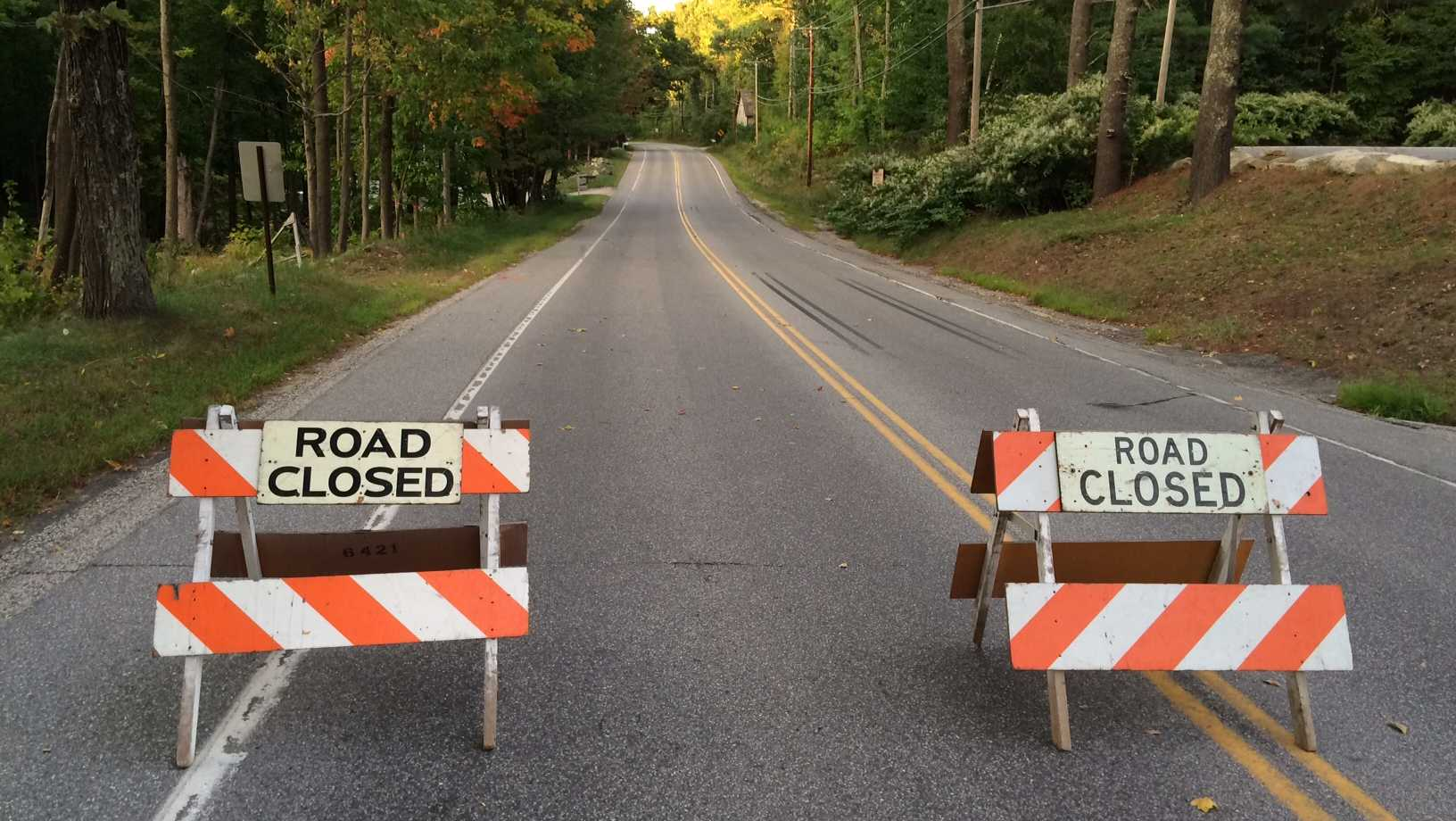 signs showing Rt. 202 in Gray is closed because of down trees