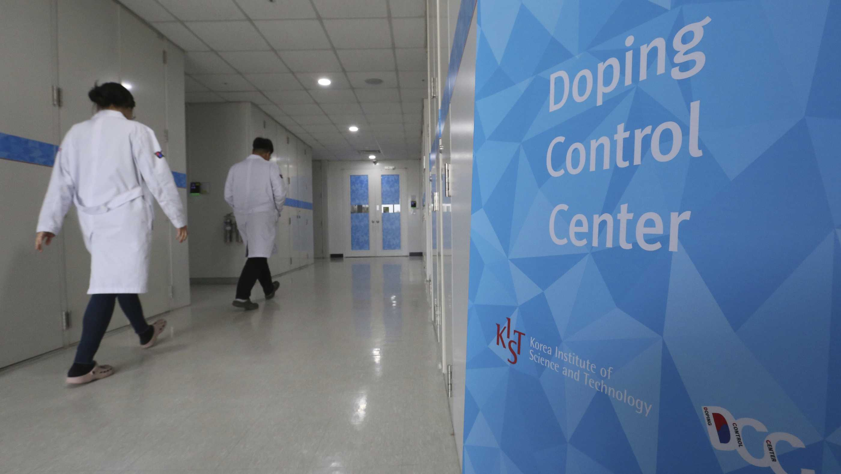 Researches enter into the Doping Control Center at the Korea Institute of Science and Technology in Seoul, South Korea, Monday, Feb. 19, 2018.