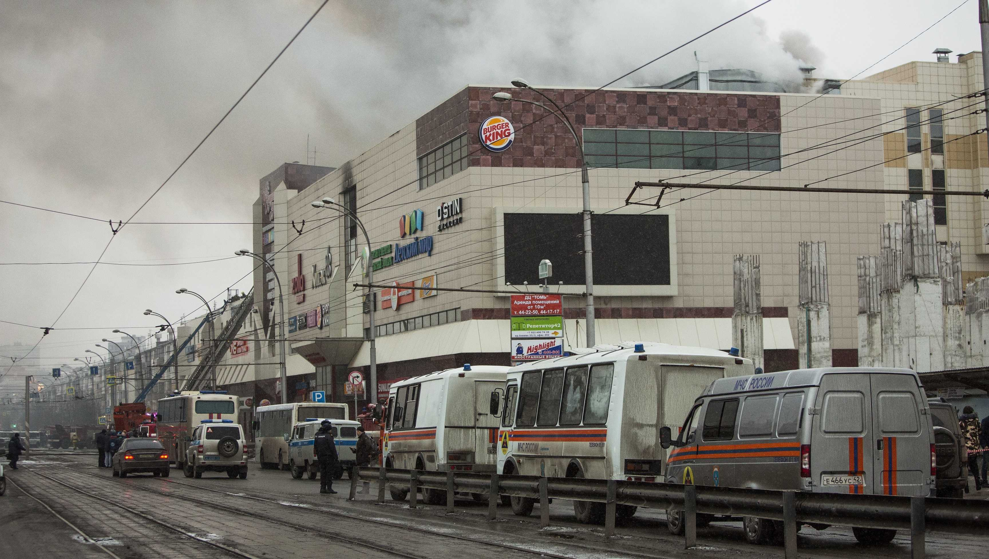 Smoke rises above a multi-story shopping center in the Siberian city of Kemerovo, about 1,900 mileseast of Moscow, Russia, on Sunday, March 25, 2018.