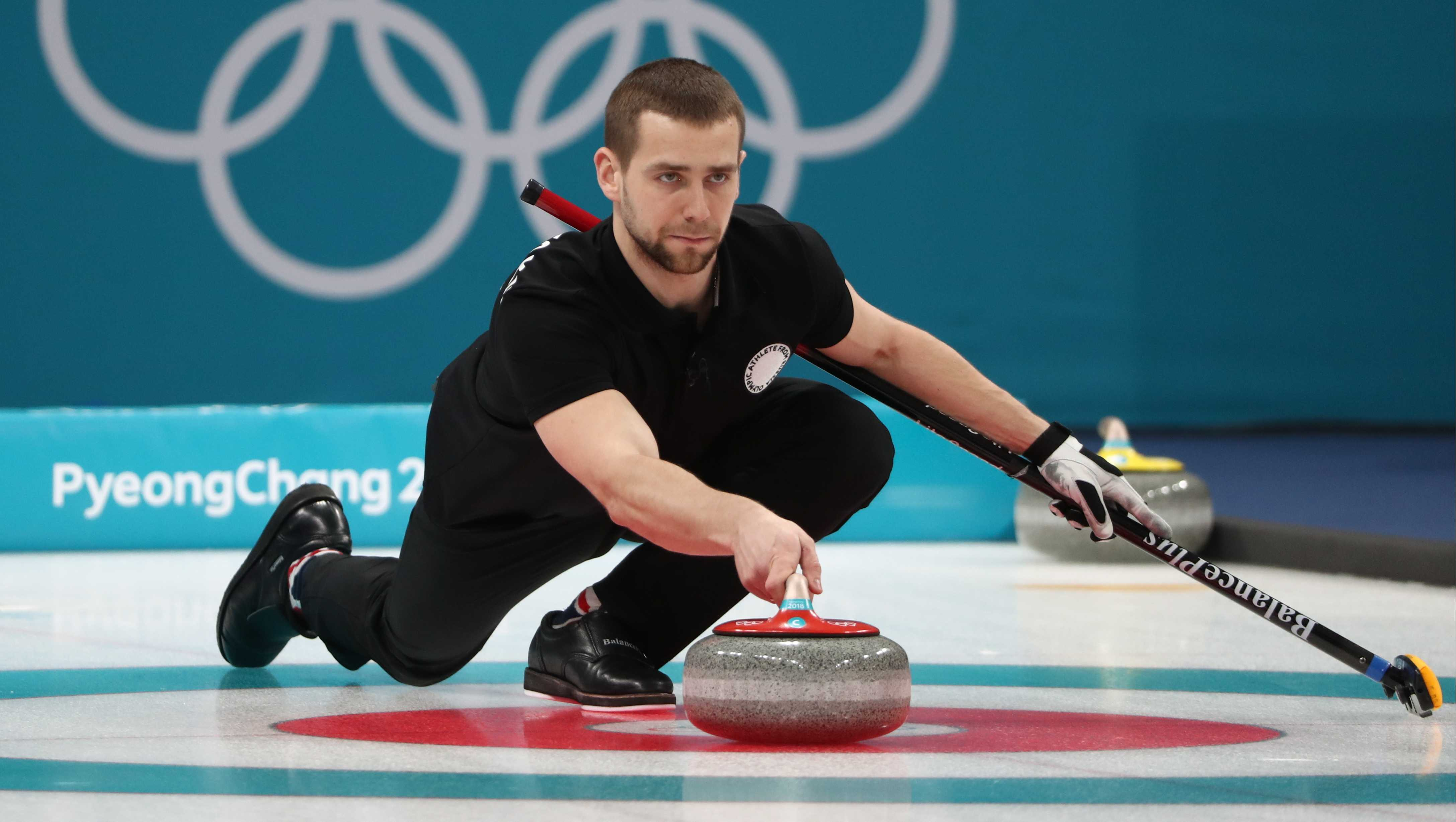 Curler Alexander Krushelnitsky, Olympic Athlete from Russia, delivers a stone in the mixed doubles curling bronze medal match with Anastasia Bryzgalova against Norway's Kristin Skaslien and Magnus Nedregotten during the 2018 Winter Olympic Games.