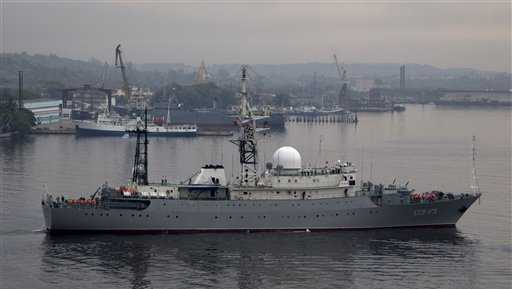 Russian warship Viktor Leonov enters the bay in Havana, Cuba, Tuesday, March 24, 2015. The Russian warship, one of the fleet's Vishnya-class ships generally used for intelligence gathering, was docked in the harbor Tuesday, coinciding with a visit to Cuba by Russia's Foreign Minister Sergei Lavrov.