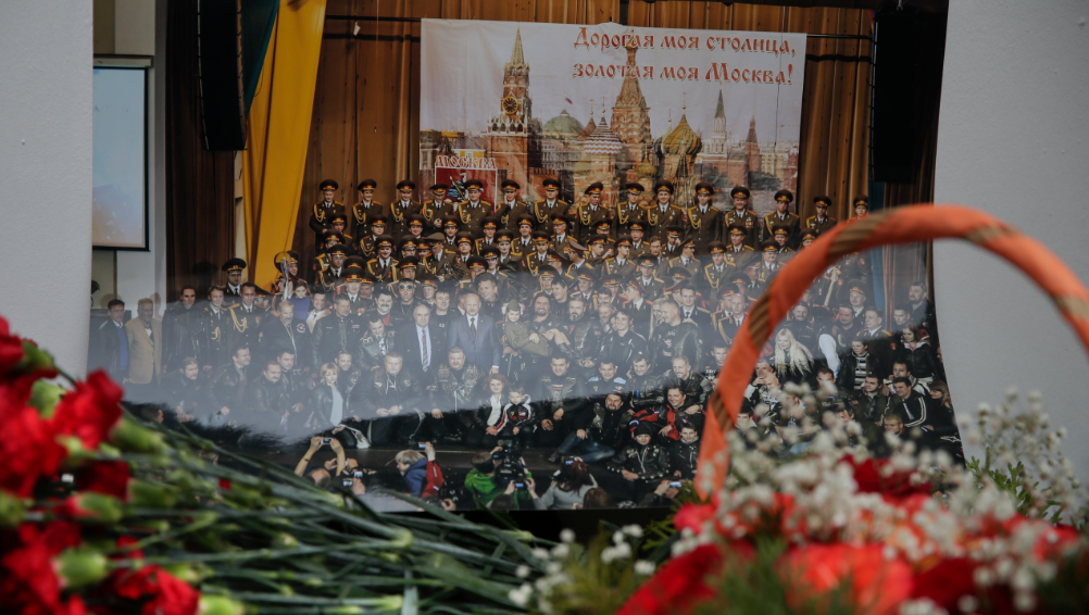 Flowers lay in front of a photo of a well-known military choir lays flowers at the military choir's building in Moscow, Russia, Sunday, Dec. 25, 2016, after a plane carrying 64 members of the Alexandrov Ensemble, crashed into the Black Sea minutes after taking off from the resort city of Sochi. The Russian plane was headed for an air base in Syria with 92 people aboard, Russia's Defense Ministry said. (AP Photo/Pavel Golovkin)