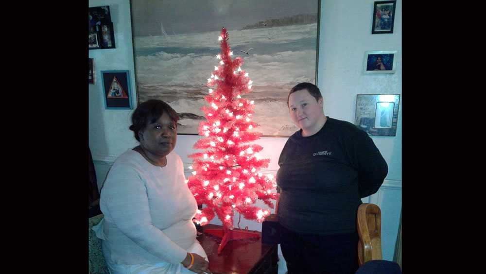 Ellen Rice and Trisha Coffman, with the tree purchased with gift from deputy
