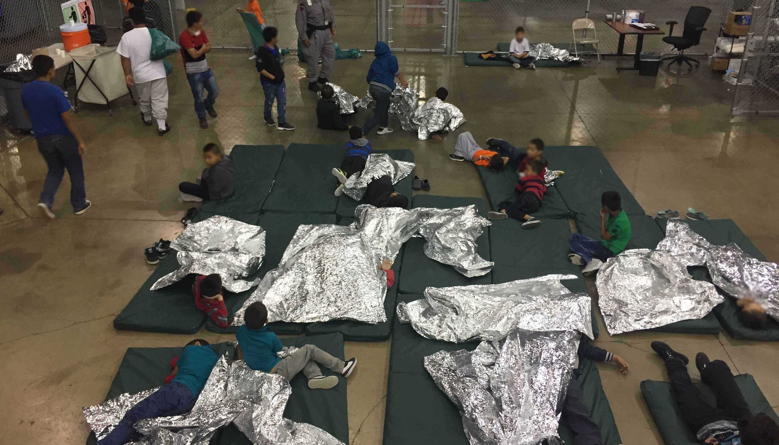 Photos released by Customs and Border Protection show chain-link fences, mattresses on the floor and families queuing to be processed at a Texas detention center.