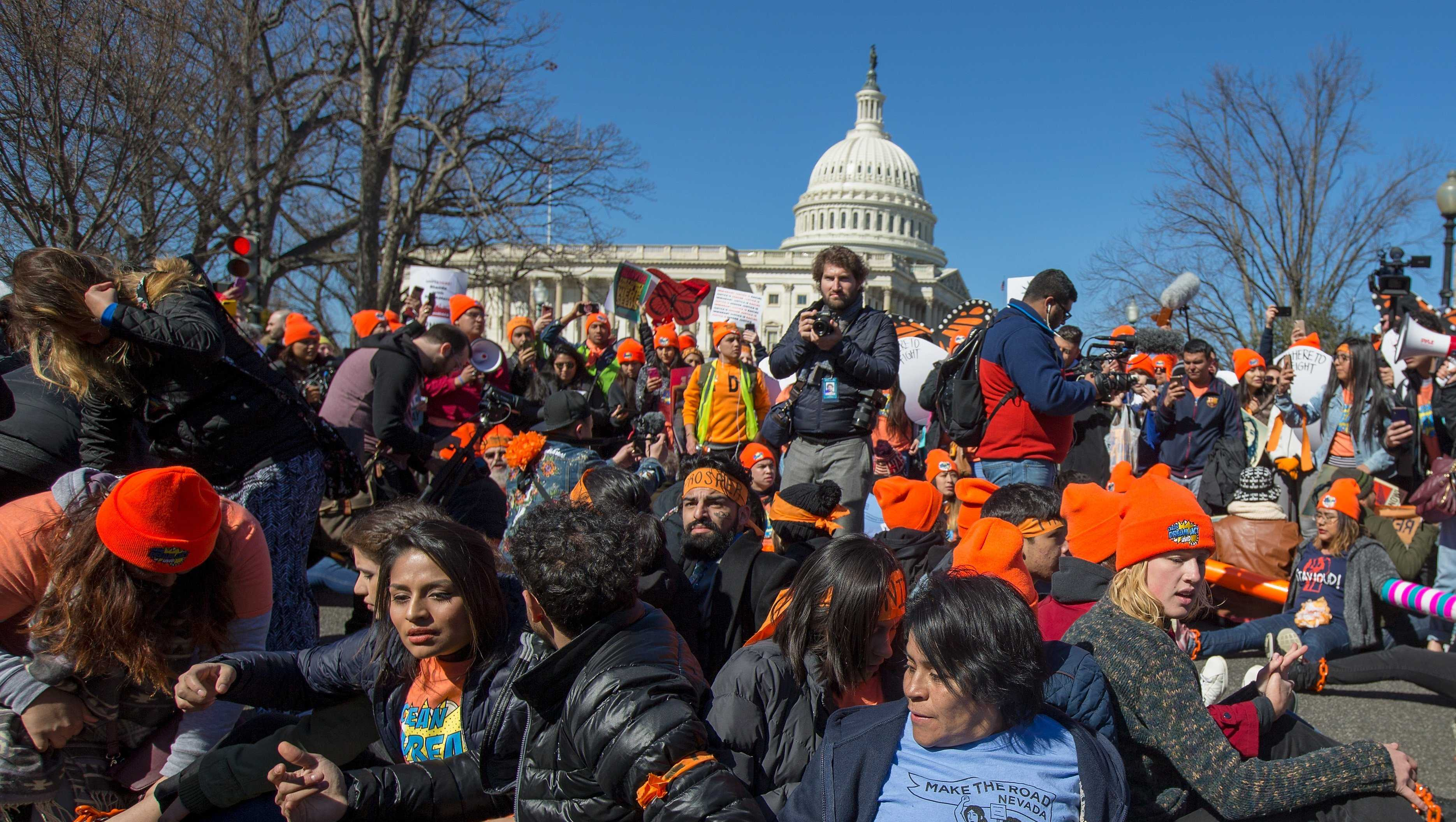 Pro DACA and Dreamer supporters chain themselves to each other outside the US Capital on March 5, 2018 in Washington, DC. 