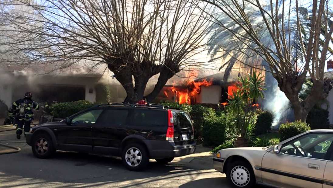 Crews battle a house fire in Sacramento on Sunday, Feb. 26, 2017, that displaced 12 people, the Sacramento Fire Department said.