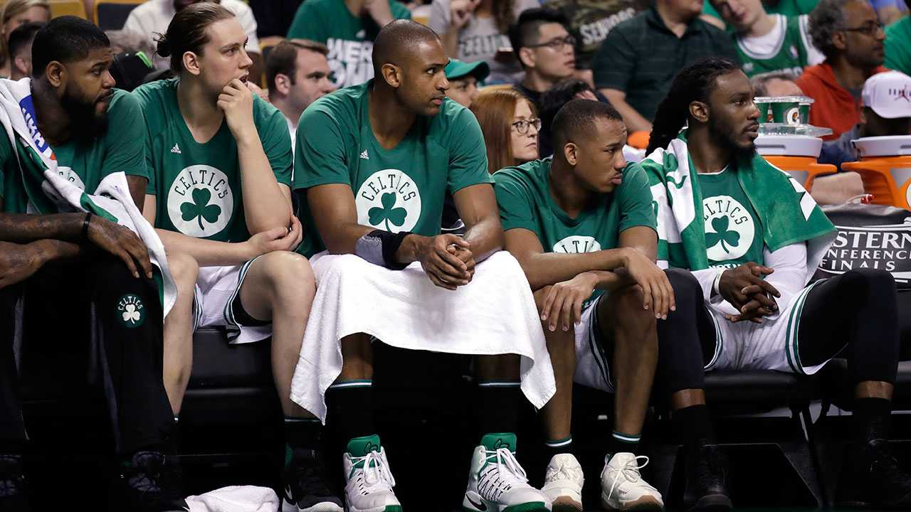 Boston Celtics players, from left, Amir Johnson, Kelly Olynyk, Al Horford, Avery Bradley and Jae Crowder watch from the bench during the second half of Game 2 of the NBA basketball Eastern Conference finals against the Cleveland Cavaliers, Friday, May 19, 2017, in Boston.