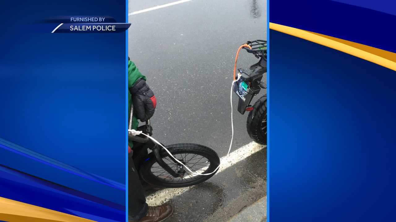 Salem teens stopped for pulling bike with scooter