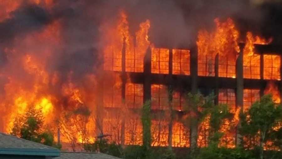 Crews battle massive fire at former shoe factory mill