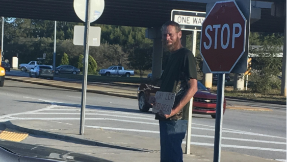 "SC Panhandler signs ""Why lie [sic] need beer?"""