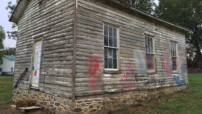 Vulgar images and racist phrases were spray painted on the Old Ashburn School in early October. (This image has been edited)