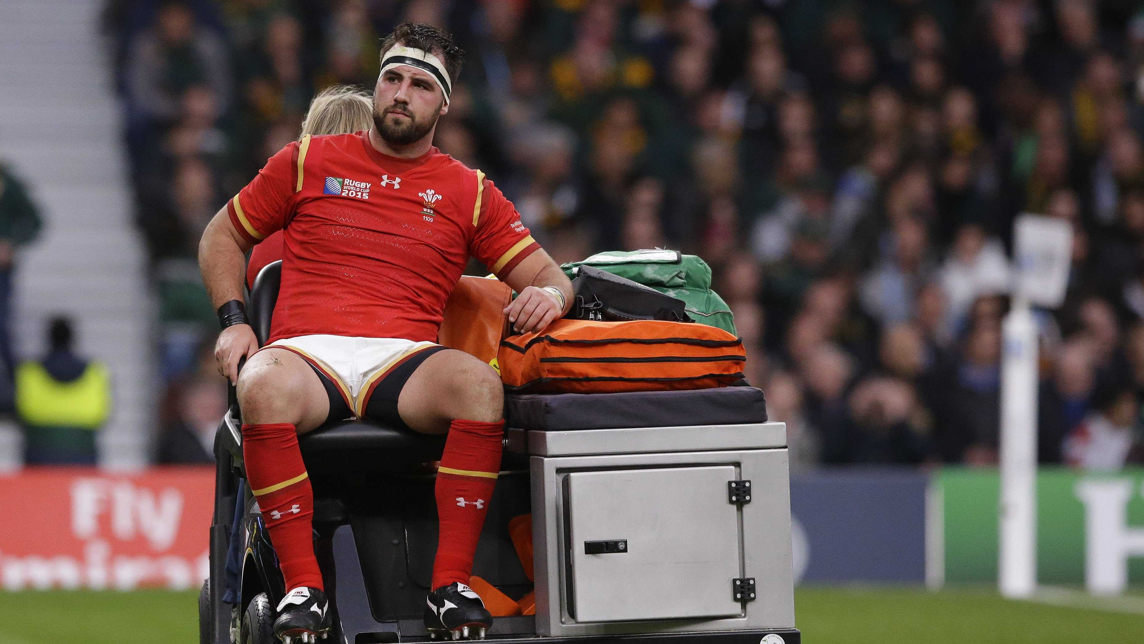 Wales' Scott Baldwin is taken from the pitch after getting injured during the Rugby World Cup quarterfinal match between South Africa and Wales at Twickenham Stadium in London, Saturday, Oct. 17, 2015.