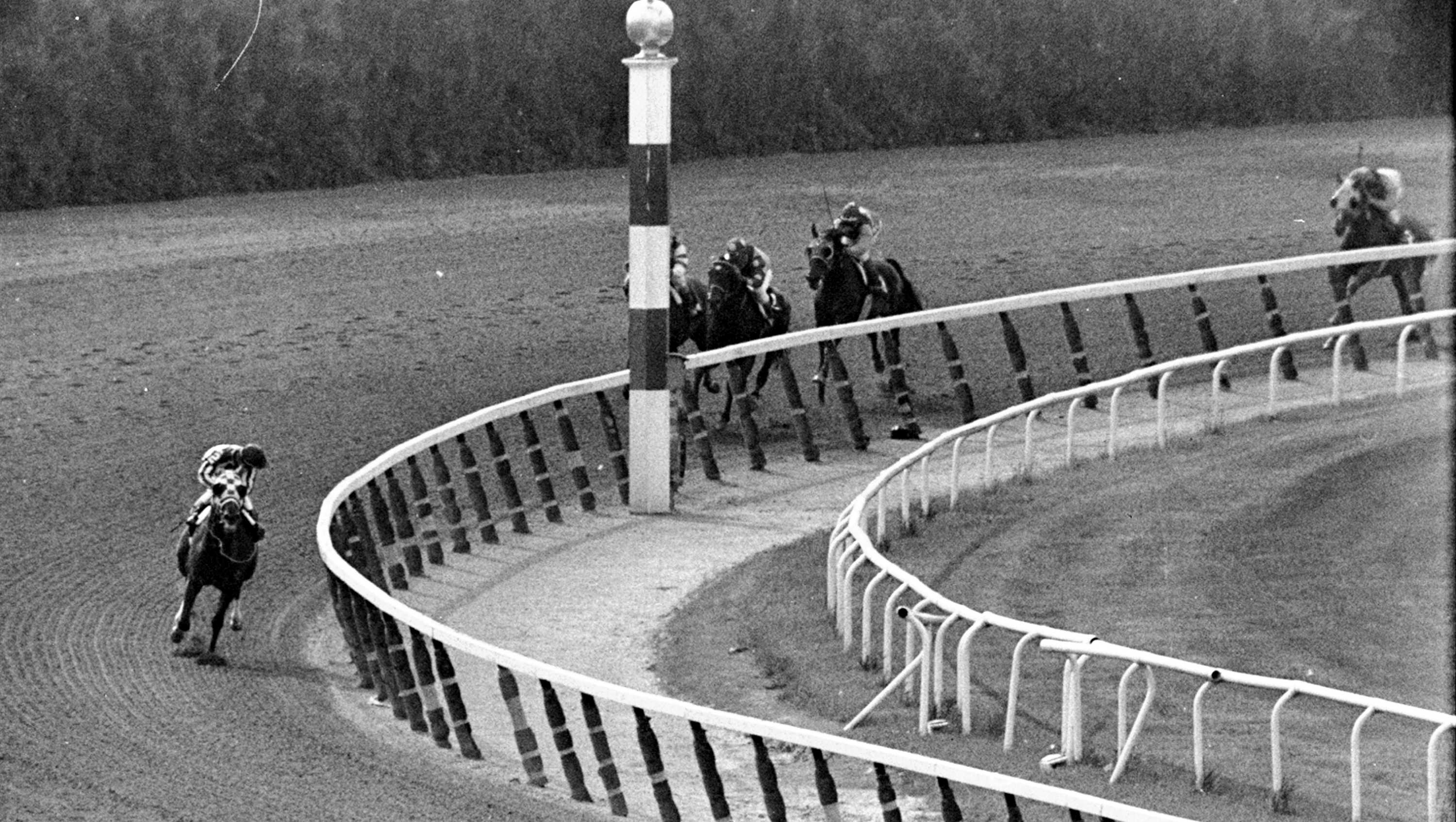 In this June 9, 1973, file photo, jockey Ron Turcotte, left, aboard Secretariat, turns for a look at the field behind, as they make the final turn on their way to winning the 1973 Triple Crown in the Belmont Stakes horse race at Belmont Park in Elmont, N.Y.