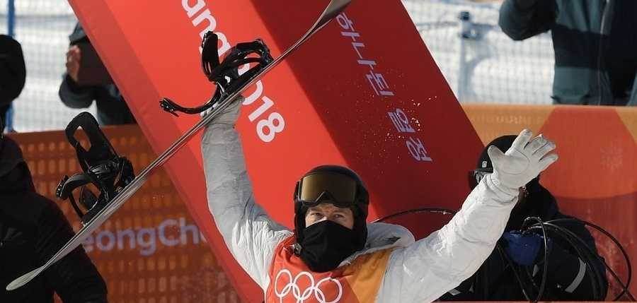Shaun White of the United States celebrates after his second run during the Snowboard Men's Halfpipe Qualification on day four of the PyeongChang 2018 Winter Olympic Games at Phoenix Snow Park on February 13, 2018