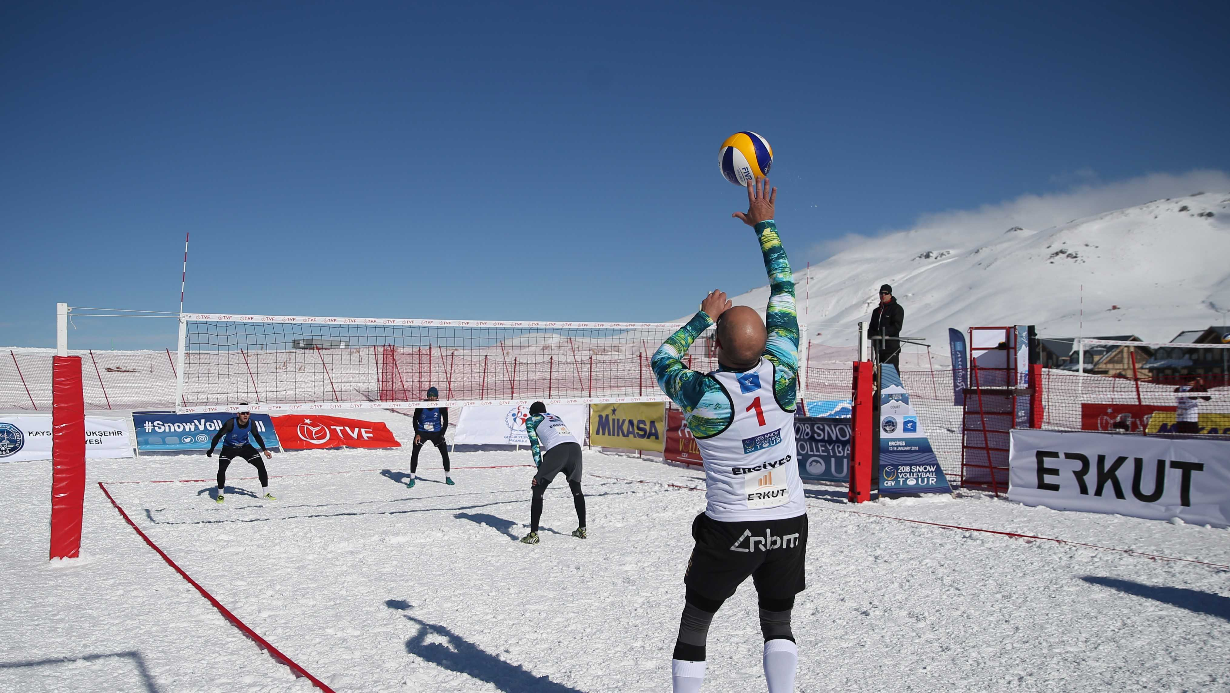 A player serves the ball in a second day match within the European Volleyball Confederation (CEV) Snow Volleyball European Tour at Erciyes Ski Resort in Kayseri, Turkey on January 13, 2018.