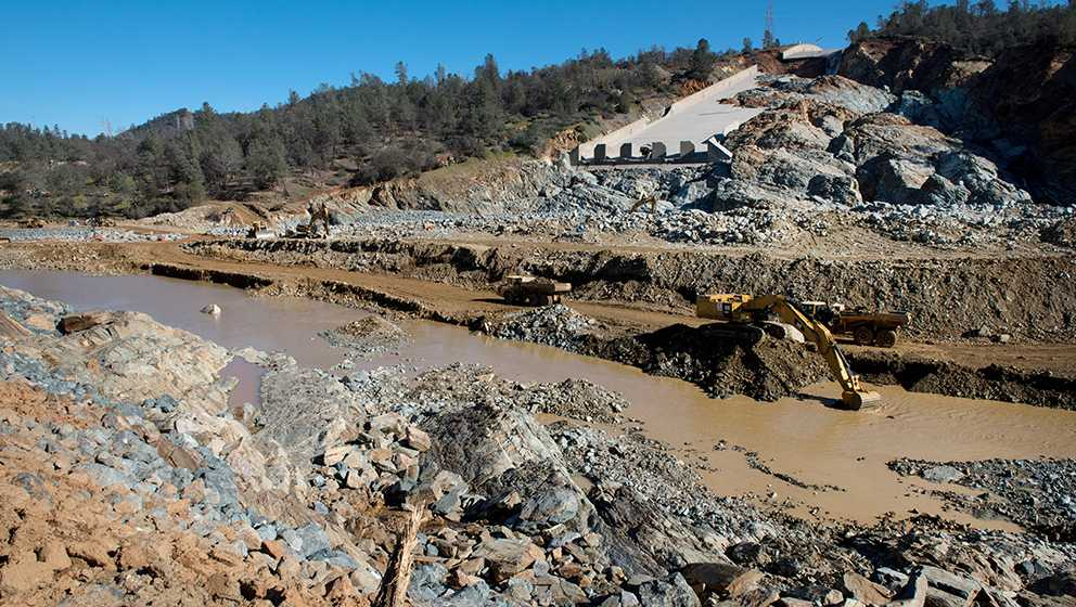 Construction crews clear debris at the base of Lake Oroville's spillways on Friday. March 3, 2017.