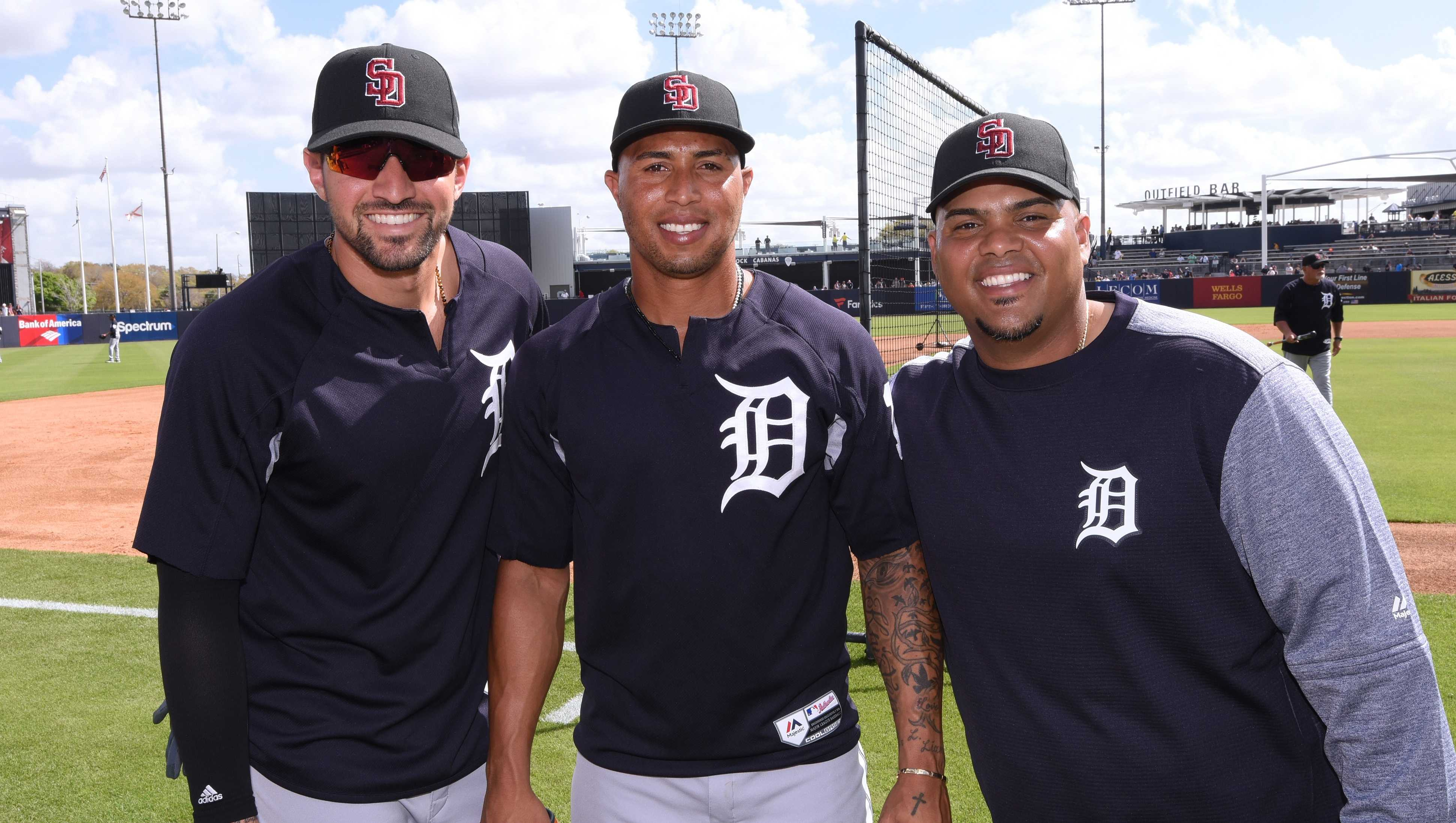 (L-R) Nicholas Castellanos #9, Leonys Martin #12 and Brayan Pena #28 of the Detroit Tigers pose for a photo while wearing special SD logo baseball hats to honor the Marjory Stoneman Douglas High School shooting victims prior to a spring training game against the New York Yankees at George M. Steinbrenner Field on February 23, 2018 in Tampa, Florida.