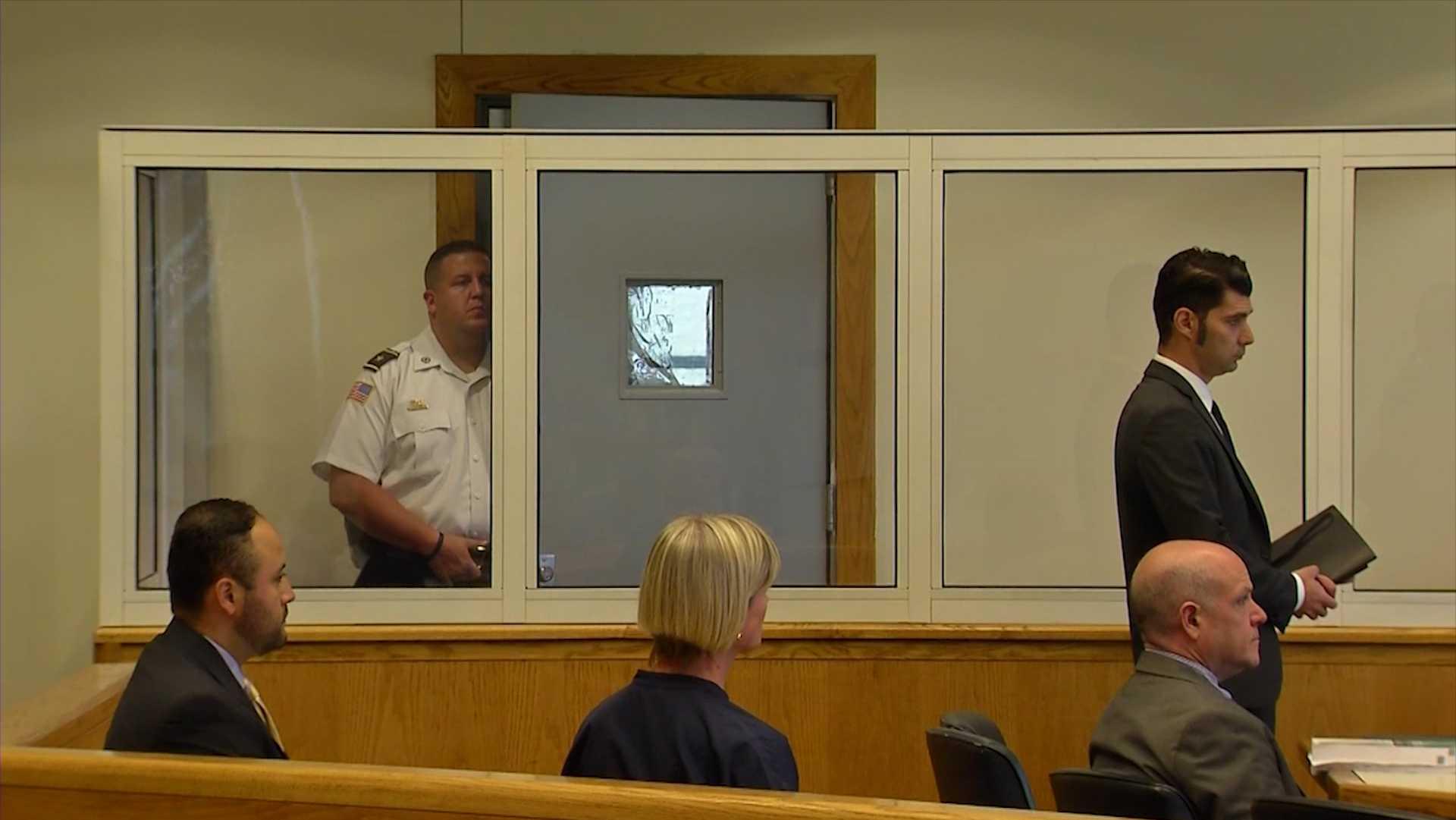 Stabbing suspect McKinley Archie concealed behind door in court
