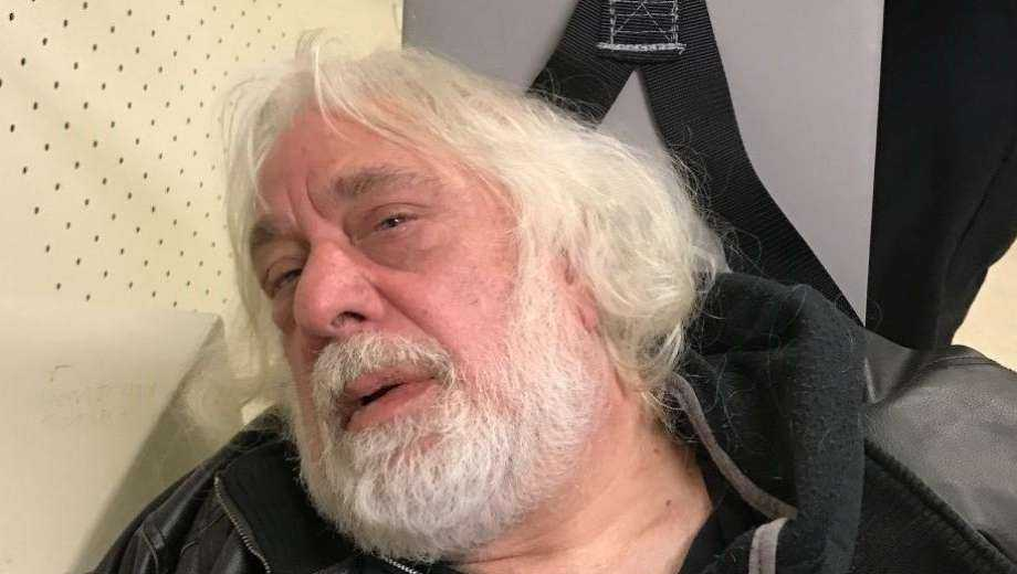 Nicholas Tartell, 61, of West Haven, pictured in a restraint chair, was charged with vandalizing two police vehicles parked next to police headquarters on Sunday.