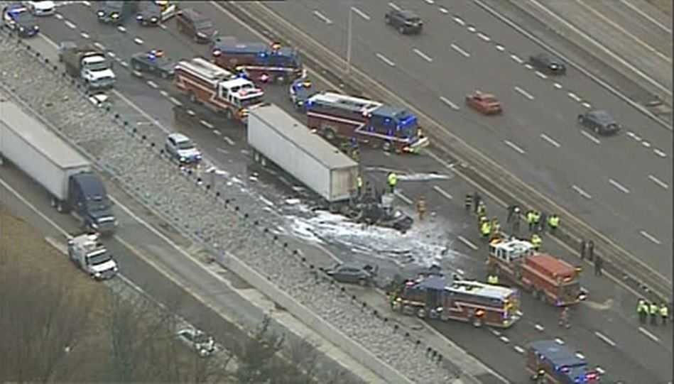 Overturned tractor-trailer shuts down 2 lanes on I-85