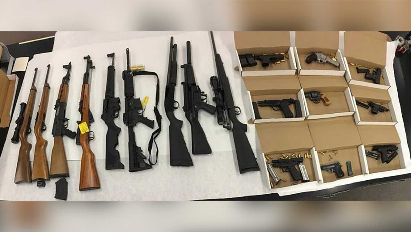 Nine rifles and nine handguns were found in a home during a probation search, the Stockton Police Department said.